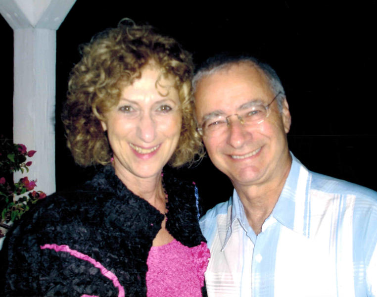 This undated family photo via the Fisher & LaMonica law firm in Chicago, shows Burton Lindner, 69, right, and Zorine Lindner, 70 of Glenview, Ill. A law firm representing relatives of the Burtons has identified them as the victims of a Wednesday, July 4, 2012, freight train derailment north of Chicago. The derailment threw 31 rail cars hauling coal off the tracks. Nearly all of them piled up on a rail bridge, causing it to collapse over a road between the suburbs of Glenview and Northbrook. (AP Photo/Family photo via the Fisher & LaMonica law firm)