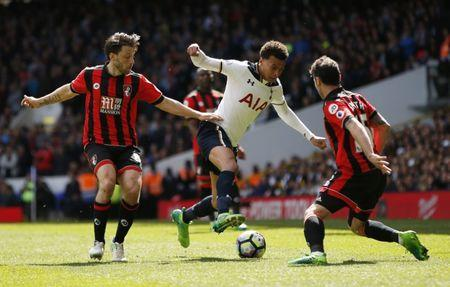 Britain Soccer Football - Tottenham Hotspur v AFC Bournemouth - Premier League - White Hart Lane - 15/4/17 Tottenham's Dele Alli in action with Bournemouth's Adam Smith and Harry Arter  Action Images via Reuters / Paul Childs Livepic