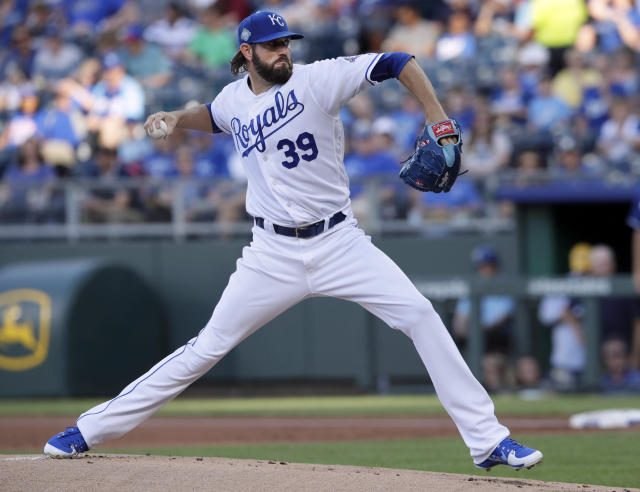 Kansas City Royals starting pitcher Jason Hammel delivers to a Texas Rangers batter during the first inning of a baseball game at Kauffman Stadium in Kansas City, Mo., Tuesday, June 19, 2018. (AP Photo/Orlin Wagner)