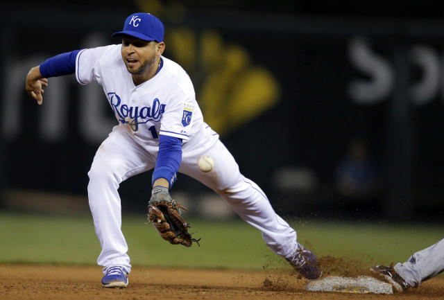 Kansas City Royals second baseman Omar Infante fails to catch a throw to force out Detroit Tigers' Andrew Romine during the fourth inning of a baseball game in Kansas City, Mo., Friday, May 2, 2014. Kansas City Royals third baseman Mike Moustakas was given a throwing error on the play. (AP Photo/Orlin Wagner)