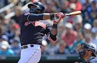 Mar 13, 2019; Goodyear, AZ, USA; Cleveland Indians shortstop Hanley Ramirez (13) hits a two RBI single against the Milwaukee Brewers during the first inning at Goodyear Ballpark. Mandatory Credit: Joe Camporeale-USA TODAY Sports