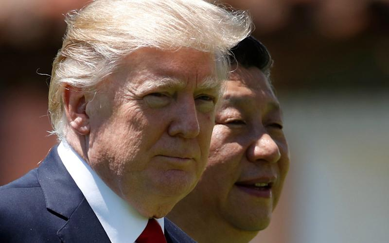 Donald Trump and Xi Jinping - Credit: AP