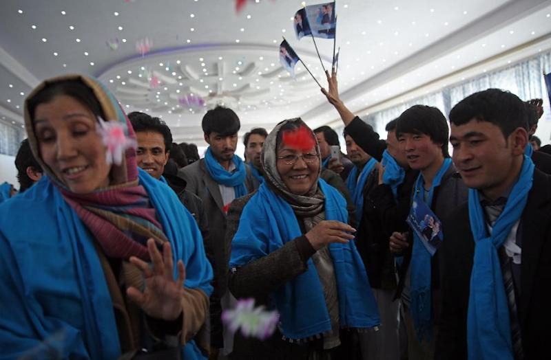 In this photo taken on Monday, March 17, 2014, Afghan vice presidential candidate, Habiba Sarabi, center, arrives to a campaign rally in Kabul, Afghanistan.(AP Photo/Massoud Hossaini)