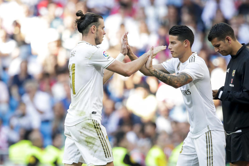 MADRID, SPAIN - OCTOBER 5: (L-R) Gareth Bale of Real Madrid, James Rodriguez of Real Madrid during the La Liga Santander match between Real Madrid v Granada at the Santiago Bernabeu on October 5, 2019 in Madrid Spain (Photo by David S. Bustamante/Soccrates/Getty Images)
