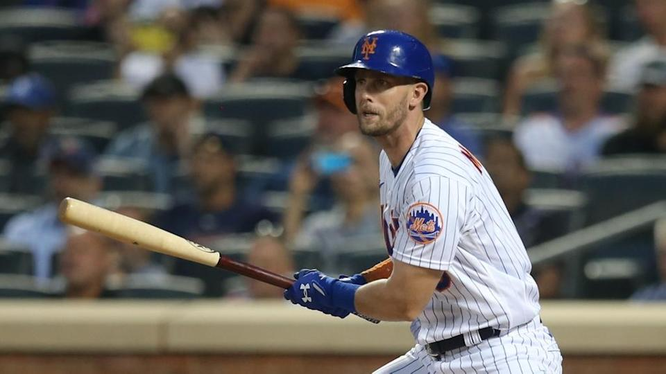 Jeff McNeil, face clearly visible, follows through on single at Citi Field July 2021