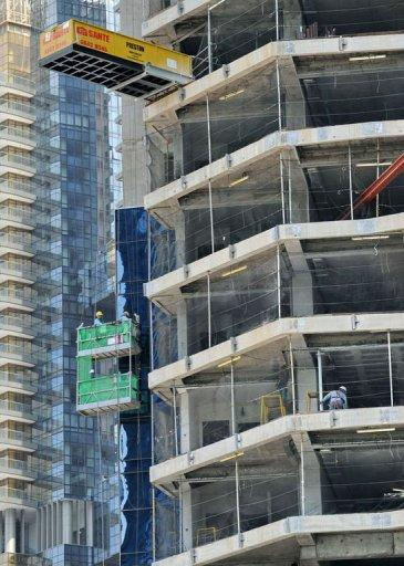 Construction workers on a building site in Singapore. Social workers in Singapore are reporting a rise in the number of foreign workers who approach them for help with cases ranging from wage disputes to assault