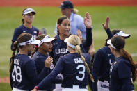 United States' Cat Osterman, center, reacts with teammates after the sixth inning of a softball game against Mexico at the 2020 Summer Olympics, Saturday, July 24, 2021, in Yokohama, Japan. (AP Photo/Matt Slocum)