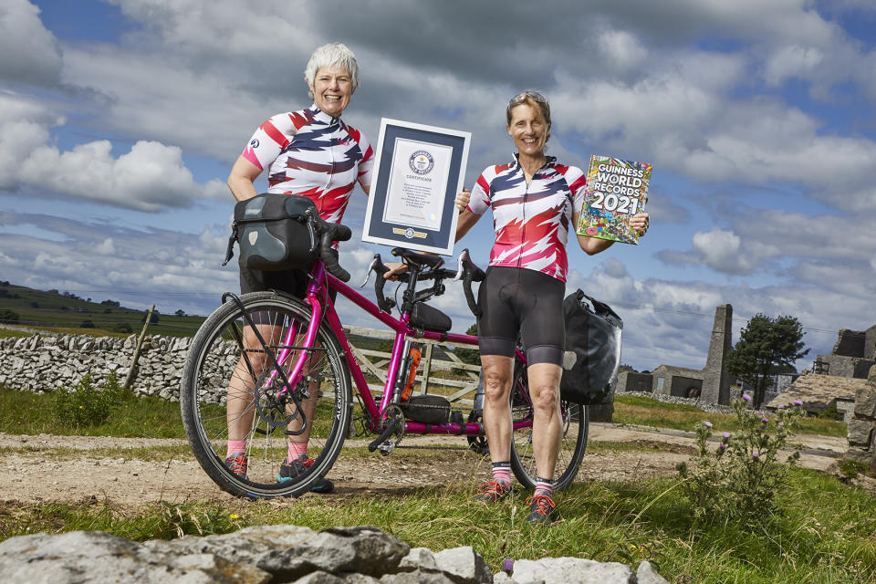 Cat Dixon, left, and Raz Marsden with their record certificate (Guinness World Records/PA)