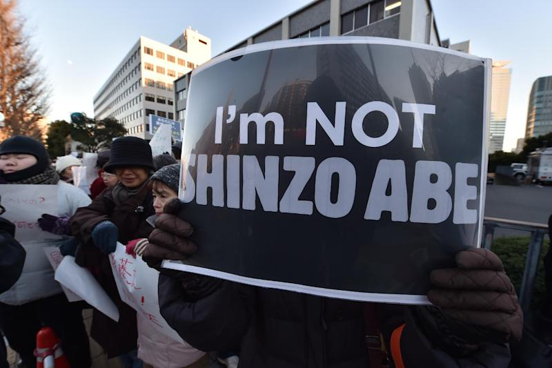 Demonstrators stage a silent rally near Prime Minister Shinzo Abe's residence in Tokyo on February 1, 2015, for Japanese hostage Kenji Goto, who was killed by the Islamic State group (AFP Photo/Kazuhiro Nogi)
