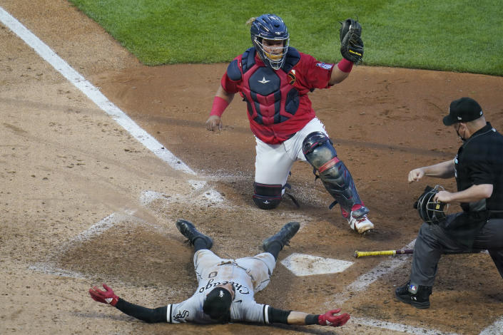 Chicago White Sox's Billy Hamilton, bottom, is tagged out by Minnesota Twins catcher Willians Astudillo, top, while trying to score from third on a triple in the fifth inning of a baseball game, Monday, May 17, 2021, in Minneapolis. (AP Photo/Jim Mone)