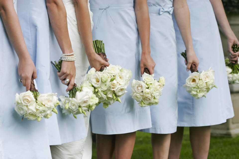 bridesmaids hold bouquets