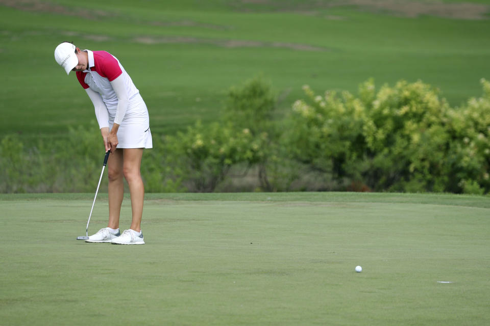 Eshter Henseleit putts on the eighth green during the third round of the LPGA Volunteers of America Classic golf tournament in The Colony, Texas, Saturday, July 3, 2021. (AP Photo/Richard W. Rodriguez)