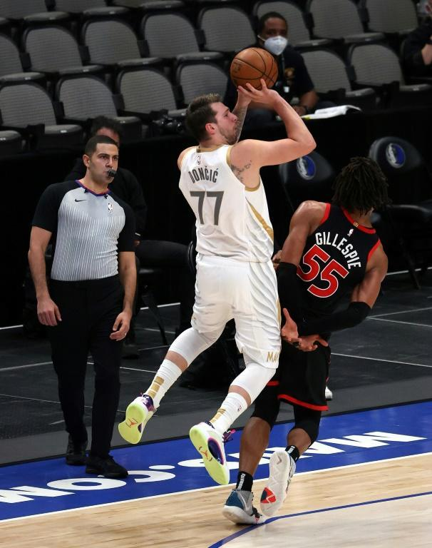 Dallas star Luka Doncic rises for a shot on the way toa triple-double in the Mavericks' 114-110 NBA victory over the Toronto Raptors