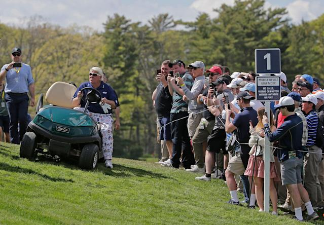 John Daly drives up to the first tee in a golf cart during the first round of the PGA Championship golf tournament, Thursday, May 16, 2019, at Bethpage Black in Farmingdale, N.Y. (AP)