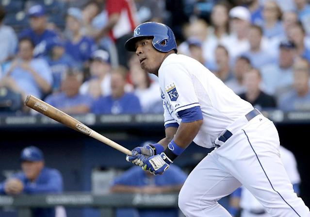 Kansas City Royals' Salvador Perez watches his ball after grounding into a double play to score a run during the first inning of a baseball game against the Oakland Athletics, Monday, Aug. 11, 2014, in Kansas City, Mo. (AP Photo/Charlie Riedel)