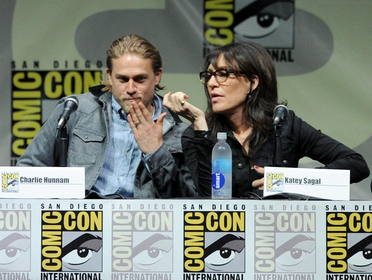 "SAN DIEGO, CA - JULY 21: Actors Charlie Hunnam (L) and Katey Sagal speak onstage at the ""Sons Of Anarchy"" panel during Comic-Con International 2013 at San Diego Convention Center on July 21, 2013 in San Diego, California. (Photo by Kevin Winter/Getty Images)"