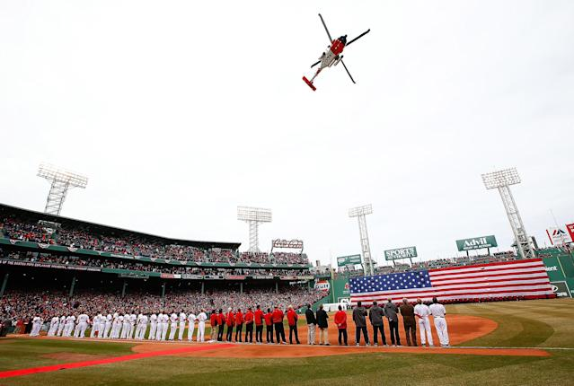 BOSTON, MA - APRIL 04: A US Coast Guard helicopter flies over Fenway Park following the national anthem prior to the Opening Day Game between the Boston Red Sox and the Milwaukee Brewers on April 4, 2014 in Boston, Massachusetts. (Photo by Jared Wickerham/Getty Images)