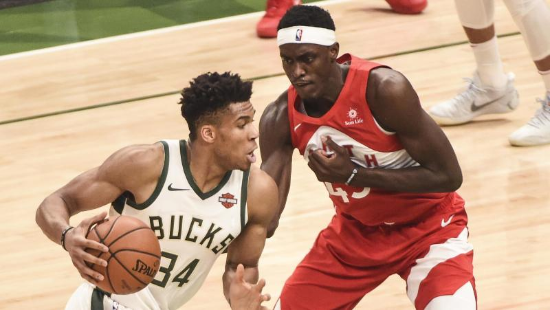 May 23, 2019; Milwaukee, WI, USA; Milwaukee Bucks forward Giannis Antetokounmpo (34) dribbles the ball as Toronto Raptors forward Pascal Siakam (43) defends in the first quarter in game five of the Eastern conference finals of the 2019 NBA Playoffs at Fiserv Forum. Mandatory Credit: Benny Sieu-USA TODAY Sports