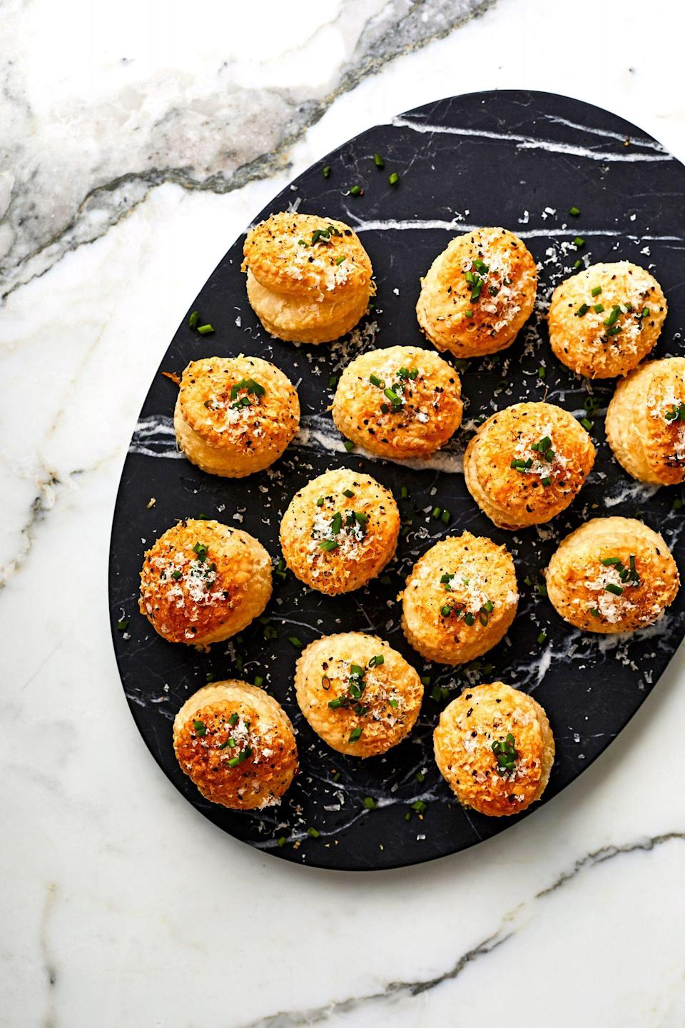 """<p><strong>Recipe: <a href=""""https://www.southernliving.com/recipes/cacio-e-pepe-puffs"""" rel=""""nofollow noopener"""" target=""""_blank"""" data-ylk=""""slk:Cacio e Pepe Puffs"""" class=""""link rapid-noclick-resp"""">Cacio e Pepe Puffs</a></strong></p> <p>Aside from frozen puff pastry sheets, you probably have all of the ingredients for these simple puffs on hand in your kitchen already. </p>"""