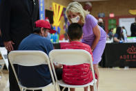 First lady Jill Biden speaks with people during a tour of a COVID-19 vaccination site at Isaac Middle School in Phoenix, Wednesday, June 30, 2021. (AP Photo/Carolyn Kaster, Pool)