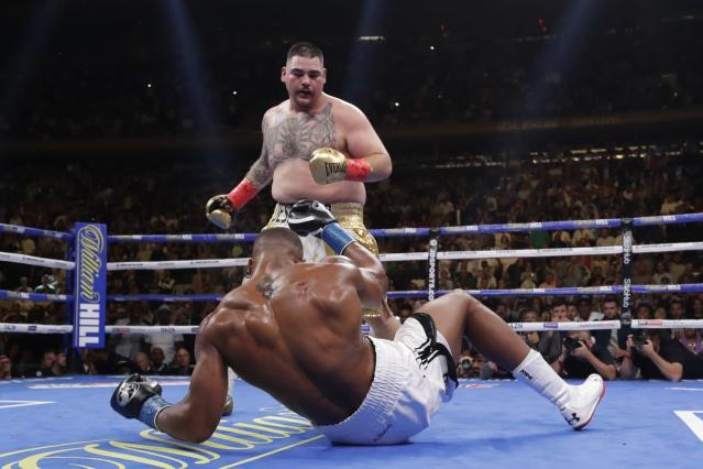 FILE - In this June 1, 2019, file photo, Andy Ruiz, above, knocks down British boxer Anthony Joshua during the third round of a heavyweight championship boxing match in New York. Three months ago in New York, Andy Ruiz scored a massive upset when he took Anthony Joshua's three heavyweight belts. (AP Photo/Frank Franklin II, File)