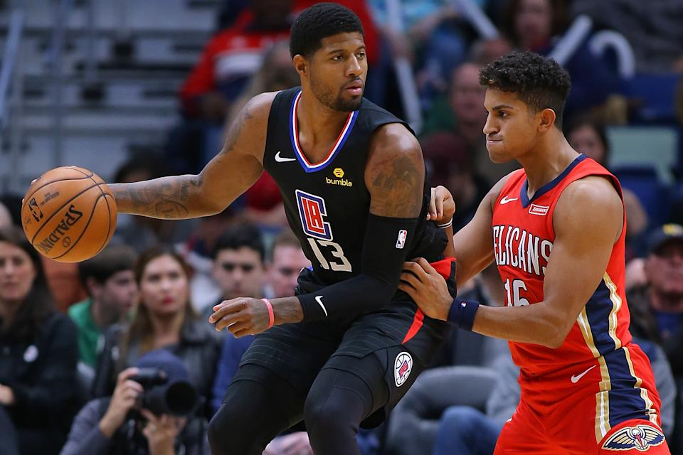 Paul George drives against Frank Jackson of the New Orleans Pelicans during the first half of their game on Thursday night at the Smoothie King Center.