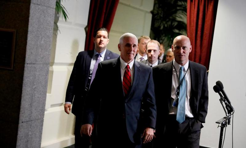 Mike Pence departs after a meeting of House Republicans on Wednesday in Washington DC.