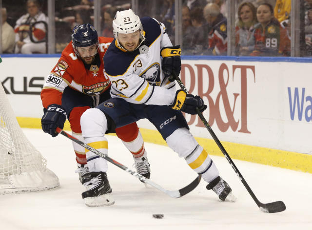 Buffalo Sabres center Sam Reinhart (23) battles for the puck with Florida Panthers defenseman Keith Yandle (3) during the first period of an NHL hockey game, Friday, March 2, 2018, in Sunrise, Fla. (AP Photo/Wilfredo Lee)