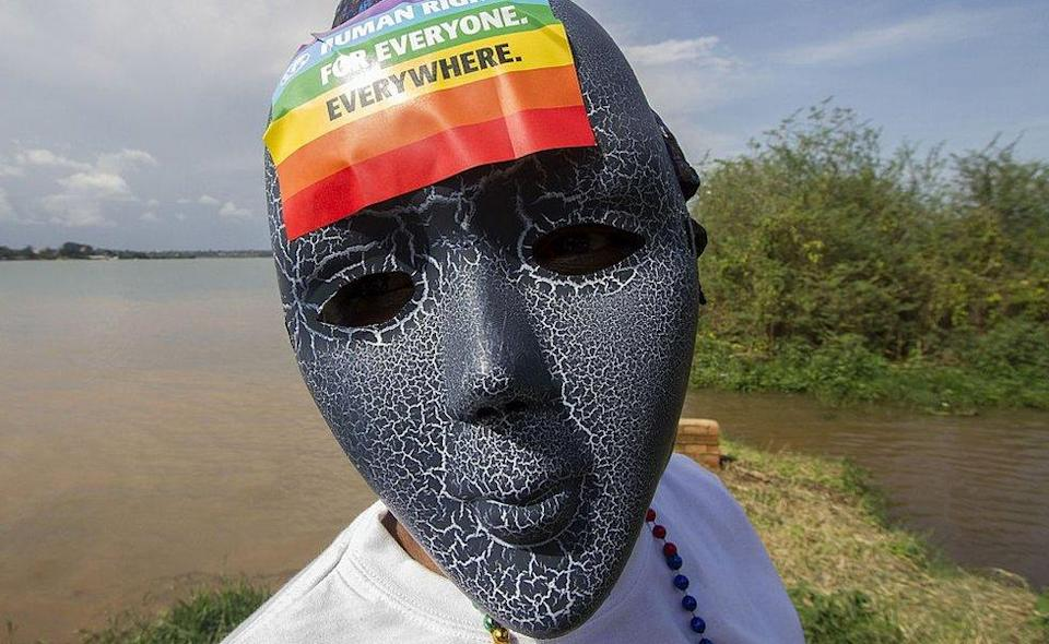 Person with a mask on and a rainbow sticker