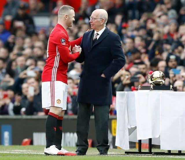 Wayne Rooney was presented with a Golden Boot by Sir Bobby Charlton after he become Manchester United's all-time leading goalscorer