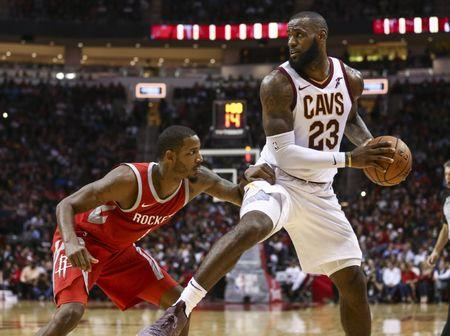 Nov 9, 2017; Houston, TX, USA; Cleveland Cavaliers forward LeBron James (23) dribbles the ball as Houston Rockets forward Trevor Ariza (1) defends during the fourth quarter at Toyota Center. Mandatory Credit: Troy Taormina-USA TODAY Sports