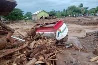 A damaged truck is seen at an area affected by flash floods after heavy rains in East Flores, East Nusa Tenggara province, Indonesia April 4, 2021, in this photo distributed by Antara Foto