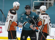 Anaheim Ducks defenseman Kevin Shattenkirk (22) and center Ryan Getzlaf (15) shakes hands with San Jose Sharks center Patrick Marleau (12) after an NHL hockey game Wednesday, April 14, 2021, in San Jose, Calif. (AP Photo/Tony Avelar)