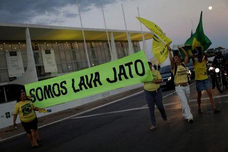 Demonstrators take part in a protest in support of Lava Jato (Car Wash) investigation, in Brasilia