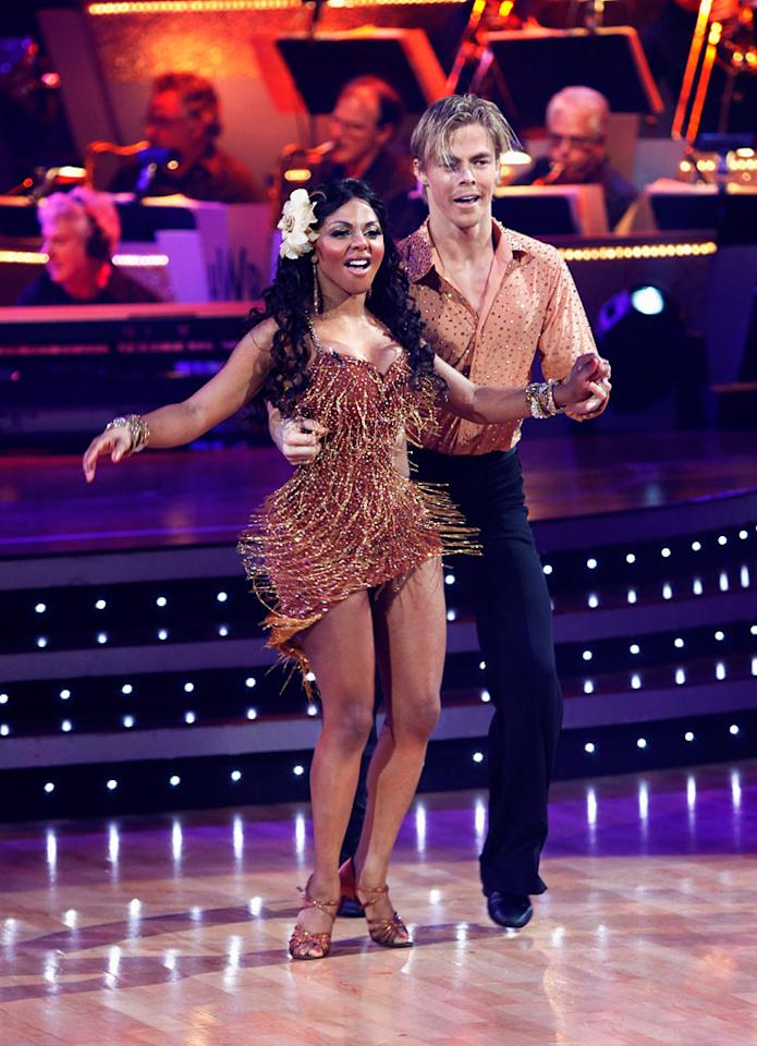 "Lil' Kim and Derek Hough perform the Salsa to ""Por Arriba, Por Abajo"" by Ricky Martin on ""Dancing with the Stars."""