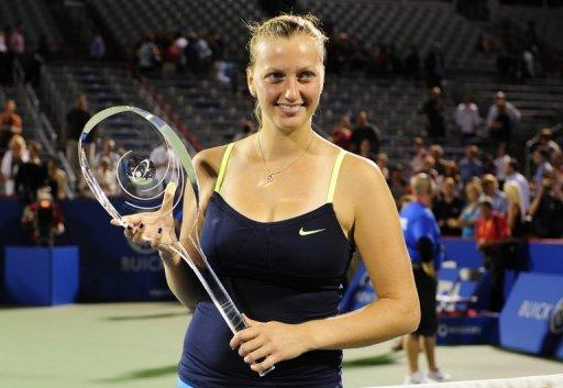 Petra Kvitova of the Czech Republic poses with the winner's trophy at the single's final of the Rogers Cup