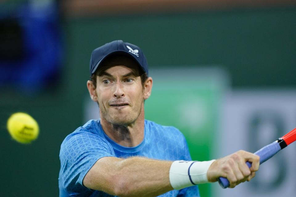 Andy Murray, of Britain, returns a shot to Adrian Mannarino, of France, at the BNP Paribas Open tennis tournament Friday Oct. 8, 2021, in Indian Wells, Calif. (AP Photo/Mark J. Terrill)