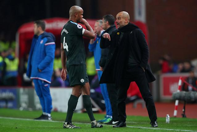 "Soccer Football - Premier League - Stoke City vs Manchester City - bet365 Stadium, Stoke-on-Trent, Britain - March 12, 2018 Manchester City's Vincent Kompany and manager Pep Guardiola REUTERS/Hannah McKay EDITORIAL USE ONLY. No use with unauthorized audio, video, data, fixture lists, club/league logos or ""live"" services. Online in-match use limited to 75 images, no video emulation. No use in betting, games or single club/league/player publications. Please contact your account representative for further details."