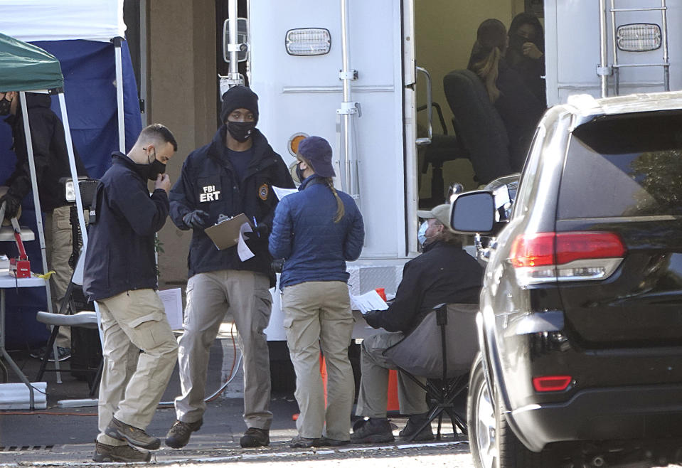 Members of the FBI Emergency Response Team continue to gather evidence at the Water's Edge apartments, Thursday, Feb. 4, 2021, in Sunrise, Fla. The complex was the scene of a shootout Monday which took the lives of two agents who were serving a warrant. (Joe Cavaretta/South Florida Sun-Sentinel via AP)
