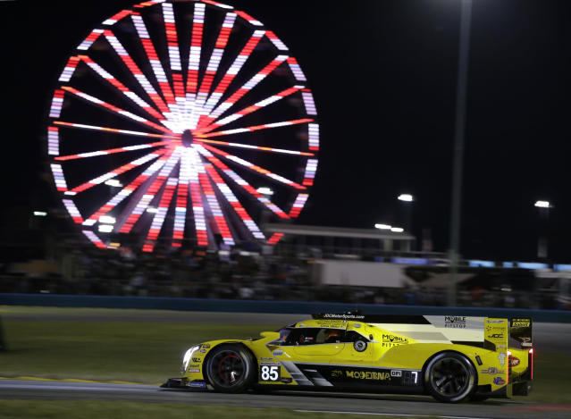 JDC-Miller MotorSports driver Chris Miller competes on the track during the Rolex 24-hour auto race at Daytona International Speedway, Saturday, Jan. 25, 2020, in Daytona Beach, Fla. (AP Photo/Terry Renna)