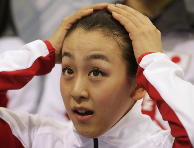 """Mao Asada of Japan reacts in the """"kiss and cry"""" area during the Team Ladies Short Program at the Sochi 2014 Winter Olympics, February 8, 2014. REUTERS/Darron Cummings/Pool (RUSSIA - Tags: SPORT FIGURE SKATING SPORT OLYMPICS)"""