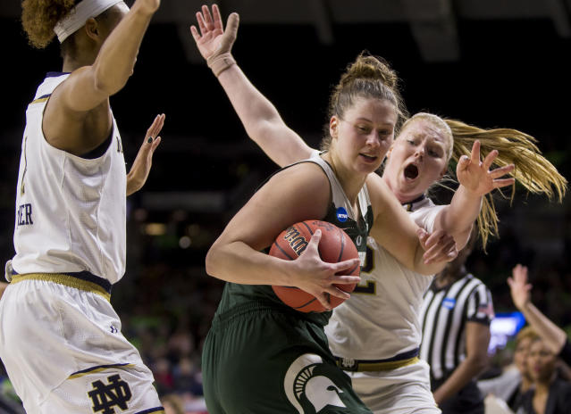 Michigan State's Jenna Allen, center, gets pressure from Notre Dame's Brianna Turner, left, and Abby Prohaska during a second-round game in the NCAA women's college basketball tournament in South Bend, Ind., Monday, March 25, 2019. (AP Photo/Robert Franklin)