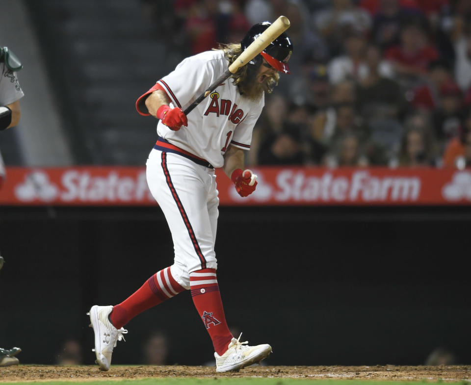 Los Angeles Angels' Brandon Marsh react to striking out with two runners on base in the sixth inning of the team's baseball game against the Oakland Athletics on Friday, July 30, 2021, in Anaheim, Calif. (AP Photo/John McCoy)