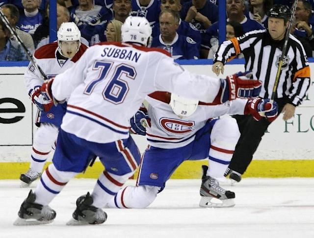 Montreal Canadiens right wing Dale Weise (22) celebrates with teammates P.K. Subban (76) and Daniel Briere (48) after scoring against the Tampa Bay Lightning during overtime of Game 1 of a first-round NHL hockey playoff series on Wednesday, April 16, 2014, in Tampa, Fla. (AP Photo/Chris O'Meara)