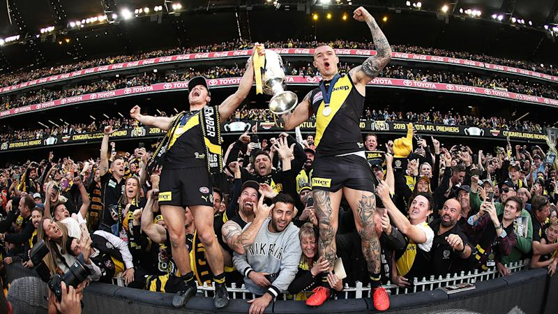 Seen here, Richmond star Dustin Martin celebrates his side's 2019 AFL premiership.