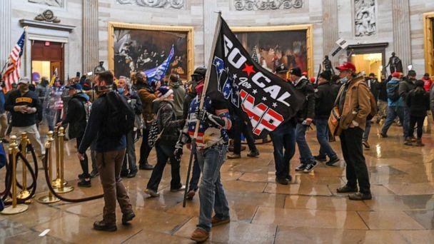 PHOTO: Supporters of President Donald Trump roam under the Capitol Rotunda after invading the Capitol building on Jan. 6, 2021, in Washington, D.C. (Saul Loeb/AFP via Getty Images)