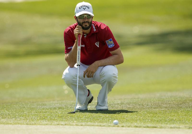 CORRECTS SPELLING TO HADWIN, INSTEAD OF HEDWIN  - Adam Hadwin, of Canada, reads a putt on the 1st hole during the third round of the Valspar Championship golf tournament Saturday, March 11, 2017, at Innisbrook in Palm Harbor, Fla. (AP Photo/Mike Carlson)