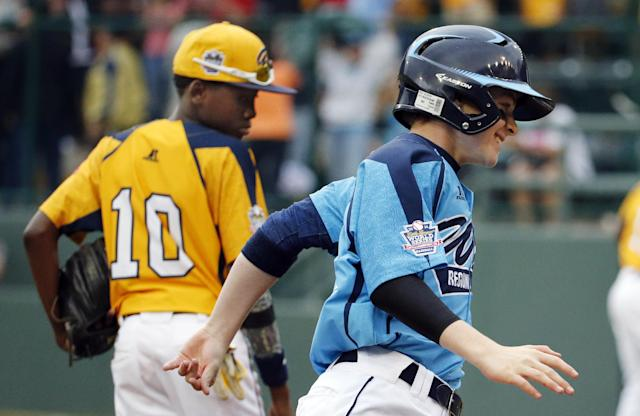 Las Vegas' Brad Stone, right, rounds third past Chicago's Cameron Bufford (10) after hitting a two-run home run in the fifth inning of the United States Championship game at the Little League World Series tournament in South Williamsport, Pa., Saturday, Aug. 23, 2014. Chicago won 7-5. (AP Photo/Gene J. Puskar)