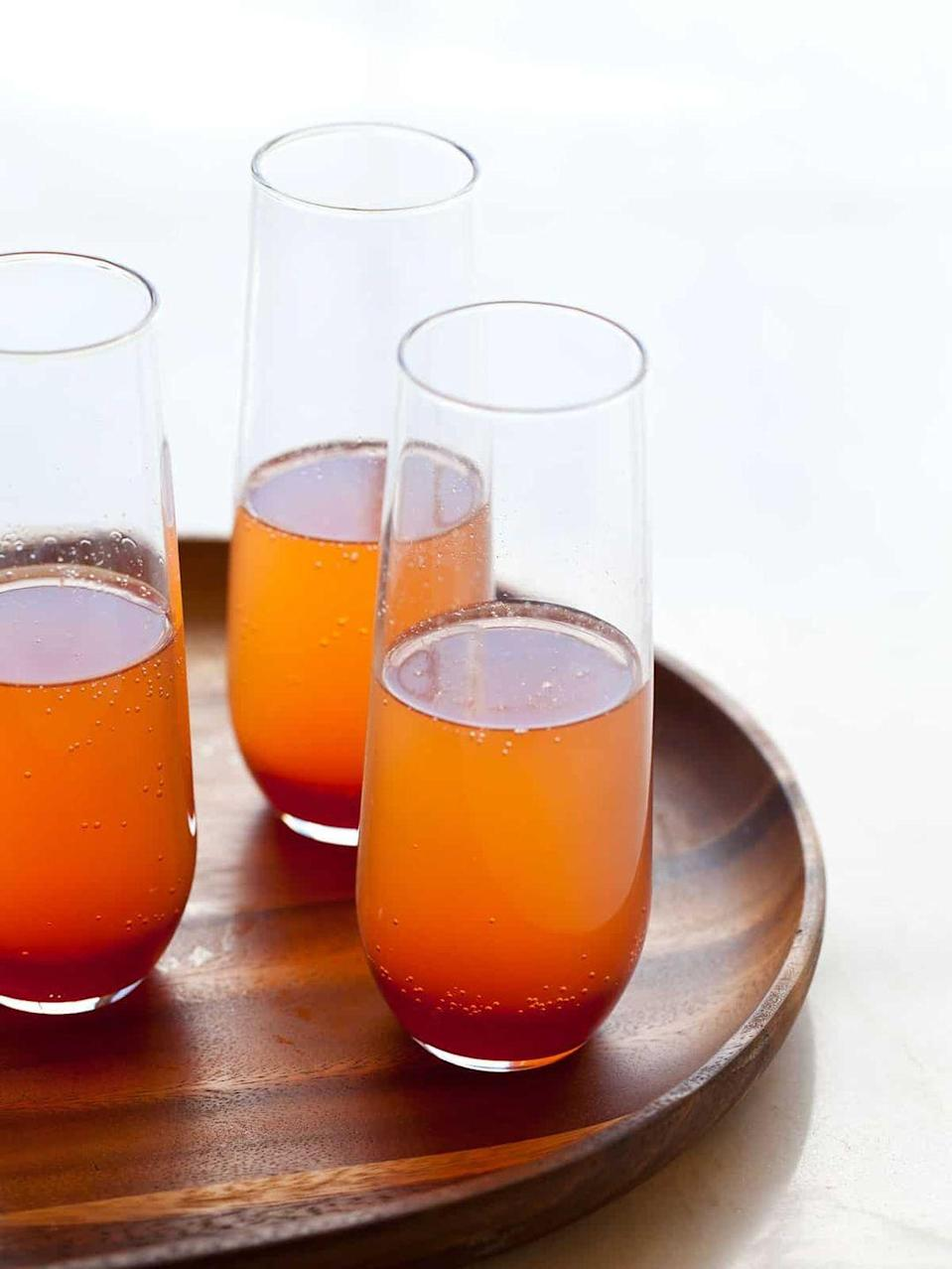 """<p>Blood orange, champagne, white wine, cinnamon—need we say more? This spiced punch is easy to throw together and its subtle spooky undertones will make it a go-to this Halloween season.</p><p><strong>Get the recipe at <a href=""""https://www.spoonforkbacon.com/spice-blood-orange-champagne-punch/"""" rel=""""nofollow noopener"""" target=""""_blank"""" data-ylk=""""slk:Spoon Fork Bacon"""" class=""""link rapid-noclick-resp"""">Spoon Fork Bacon</a>.</strong></p><p><a class=""""link rapid-noclick-resp"""" href=""""https://go.redirectingat.com?id=74968X1596630&url=https%3A%2F%2Fwww.walmart.com%2Fip%2FLibbey-Polaris-16-25-oz-Clear-Drinking-Glasses-8-ct-Box%2F54562994&sref=https%3A%2F%2Fwww.thepioneerwoman.com%2Fholidays-celebrations%2Fg36792938%2Fhalloween-punch-recipes%2F"""" rel=""""nofollow noopener"""" target=""""_blank"""" data-ylk=""""slk:SHOP GLASSES"""">SHOP GLASSES</a></p>"""