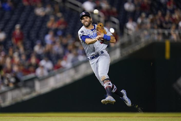 Chris Taylor leaps and makes a throw.